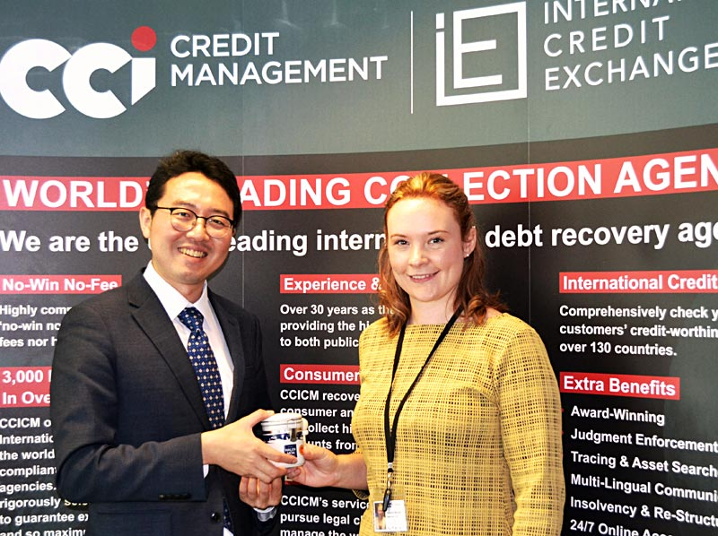 Debt Collection Korea Attorney at Law, Howon Lee, receives a gift of local Welsh salt from ICE Operations Manager Hannah Barratt