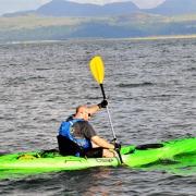 Tom enjoying his maiden kayak 'sea trials' voyage near head office off the Snowdonia coast